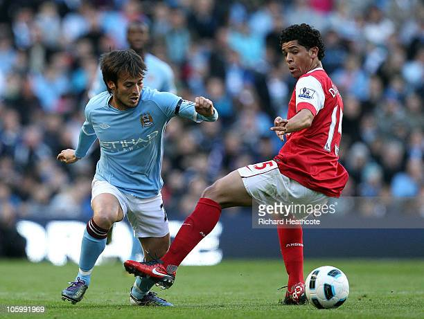 David Silva of City goes past Denilson of Arsenal during the Barclays Premier League match between Manchester City and Arsenal at City of Manchester...