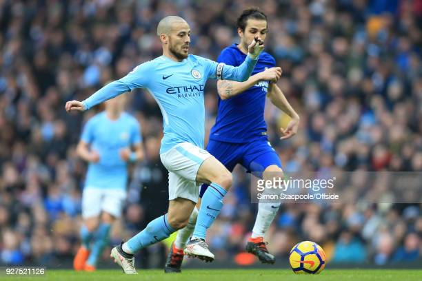 David Silva of Man City battles with Cesc Fabregas of Chelsea during the Premier League match between Manchester City and Chelsea at the Etihad...
