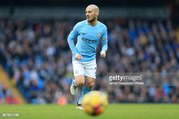 David Silva of Man City in action during the Premier League match between Manchester City and Chelsea at the Etihad Stadium on March 4 2018 in...