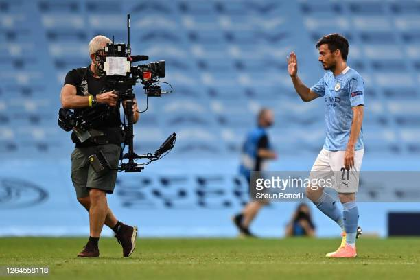 David Silva of Manchester City acknowledges the TV Camera following the UEFA Champions League round of 16 second leg match between Manchester City...