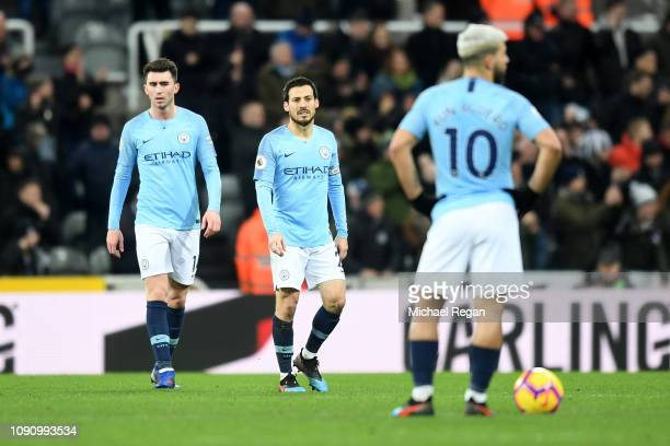 David Silva of Manchester City and Aymeric Laporte of Manchester City look dejected after Newcastle United score their second goal during the Premier...