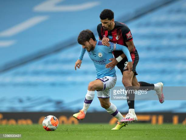 David Silva of Manchester City and Dominic Solanke of AFC Bournemouth in action during the Premier League match between Manchester City and AFC...