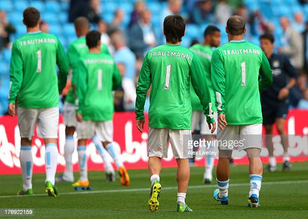 David Silva of Manchester City and his team mates wear the name of Bert Trautmann on their shirts in memory of the former goalkeeper who died in July...