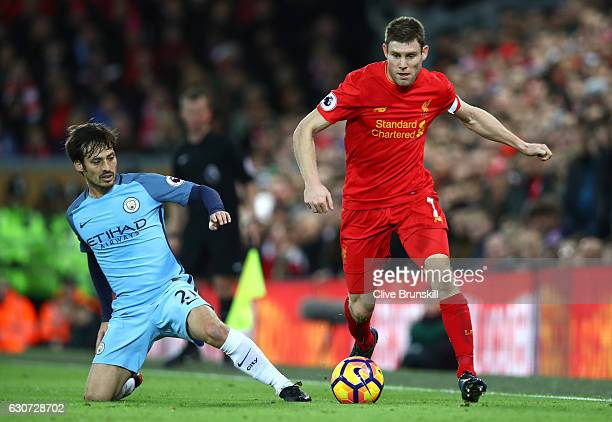 David Silva of Manchester City and James Milner of Liverpool clash uring the Premier League match between Liverpool and Manchester City at Anfield on...