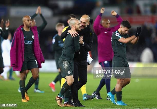 David Silva of Manchester City and Josep Guardiola Manager of Manchester City celebrate vicotry after the Premier League match between Swansea City...