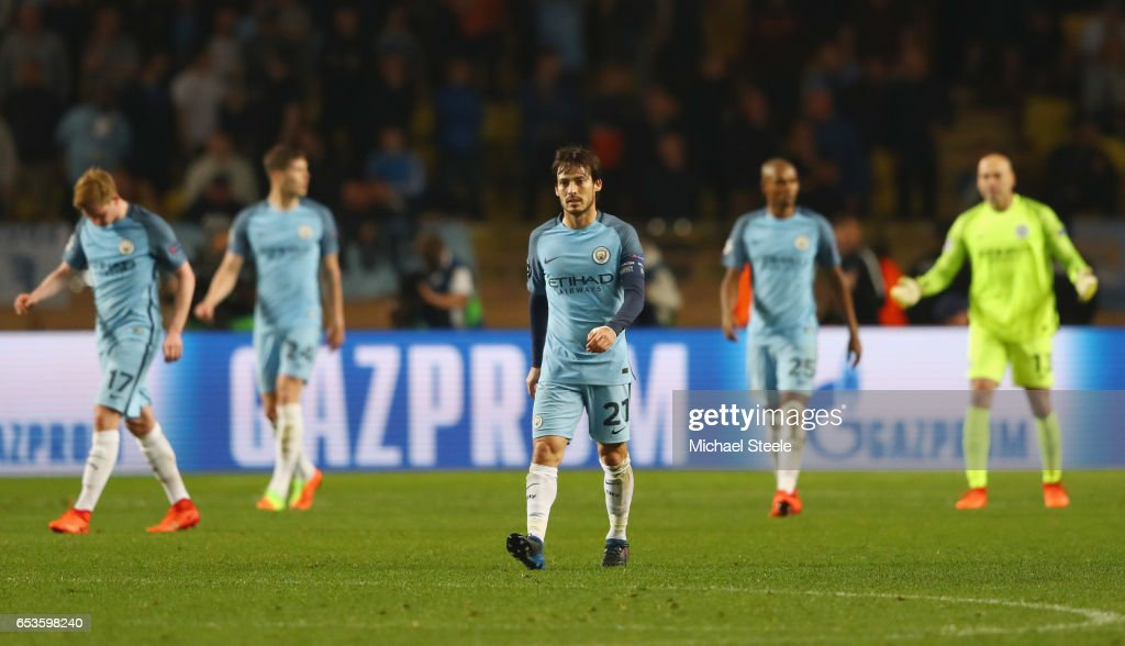 David Silva of Manchester City (21) and ream mates look dejected as Tiemoue Bakayoko of AS Monaco scores their third goal during the UEFA Champions League Round of 16 second leg match between AS Monaco and Manchester City FC at Stade Louis II on March 15, 2017 in Monaco, Monaco.