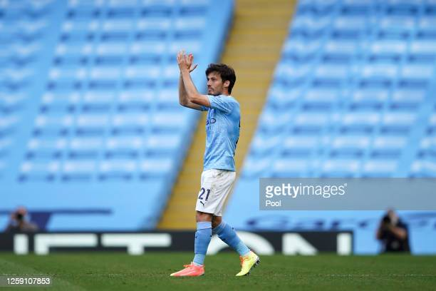 David Silva of Manchester City applauds as he is substituted during the Premier League match between Manchester City and Norwich City at Etihad...