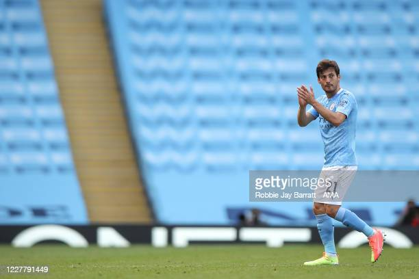 David Silva of Manchester City applauds as he is substituted off for his final league home appearance for the club during the Premier League match...