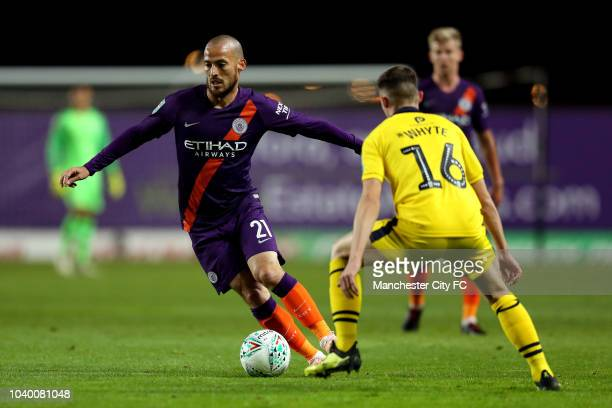 David Silva of Manchester City attempts to get past Gavin Whyte of Oxford United during the Carabao Cup Third Round match between Oxford United and...