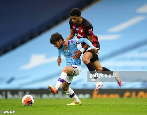 David Silva of Manchester City battles for possession with Dominic Solanke of AFC Bournemouth during the Premier League match between Manchester City...