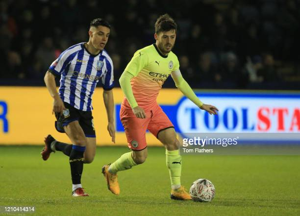 David Silva of Manchester City battles for possession with Joey Pelupessy of Sheffield Wednesday during the FA Cup Fifth Round match between...