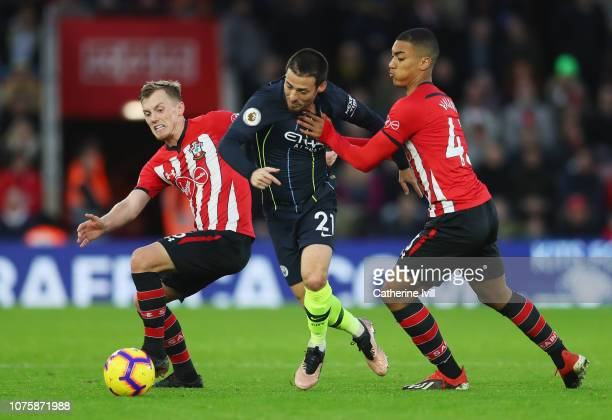 David Silva of Manchester City battles with James WardProwse of Southampton and Yan Valery of Southampton during the Premier League match between...
