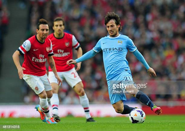 David Silva of Manchester City breaks with the ball during the Barclays Premier League match between Arsenal and Manchester City at Emirates Stadium...