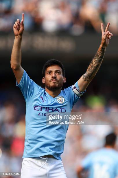 David Silva of Manchester City celebrates after scoring a goal to make it 1-0 during the Premier League match between Manchester City and Watford FC...