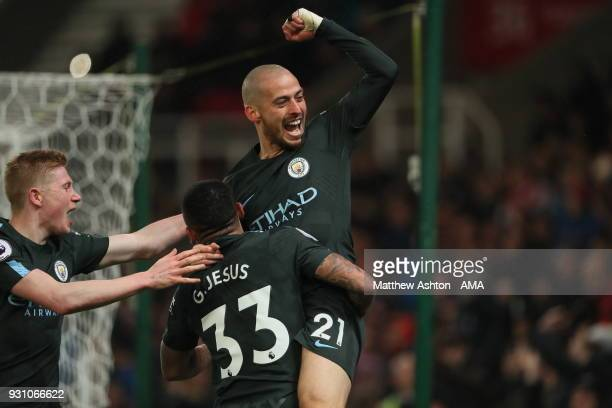David Silva of Manchester City celebrates after scoring a goal to make it 20 during the Premier League match between Stoke City and Manchester City...