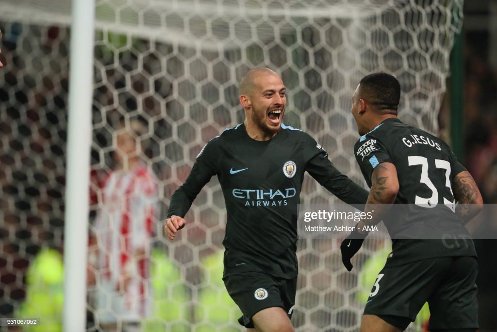 David Silva of Manchester City celebrates after scoring a goal to make it 2-0 during the Premier League match between Stoke City and Manchester City at Bet365 Stadium on March 12, 2018 in Stoke on Trent, England.
