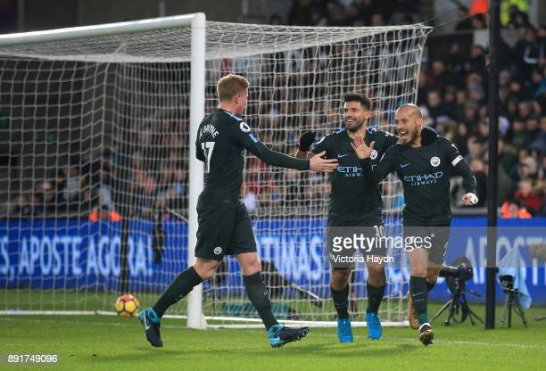 David Silva of Manchester City celebrates after scoring his sides first goal with his team mates during the Premier League match between Swansea City...