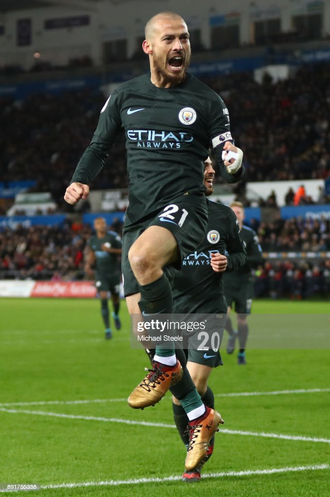 david silva of manchester city celebrates after scoring his sides third goal during the premier league