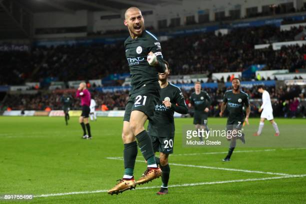 David Silva of Manchester City celebrates after scoring his sides third goal during the Premier League match between Swansea City and Manchester City...