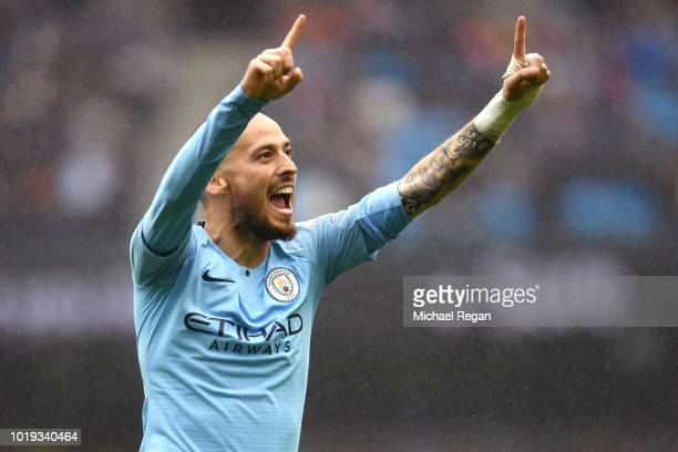 David Silva of Manchester City celebrates after scoring his team's fourth goal during the Premier League match between Manchester City and...