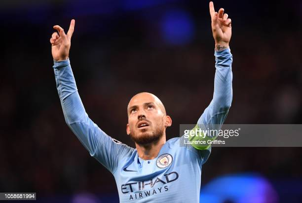 David Silva of Manchester City celebrates after scoring his team's first goal during the Group F match of the UEFA Champions League between...