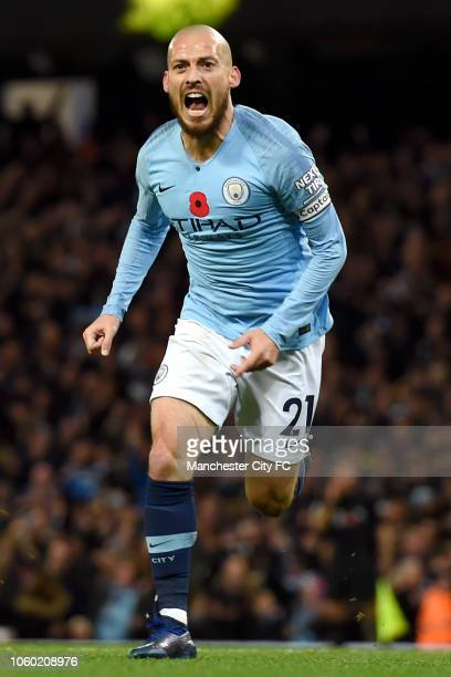 David Silva of Manchester City celebrates after scoring his team's first goal during the Premier League match between Manchester City and Manchester...