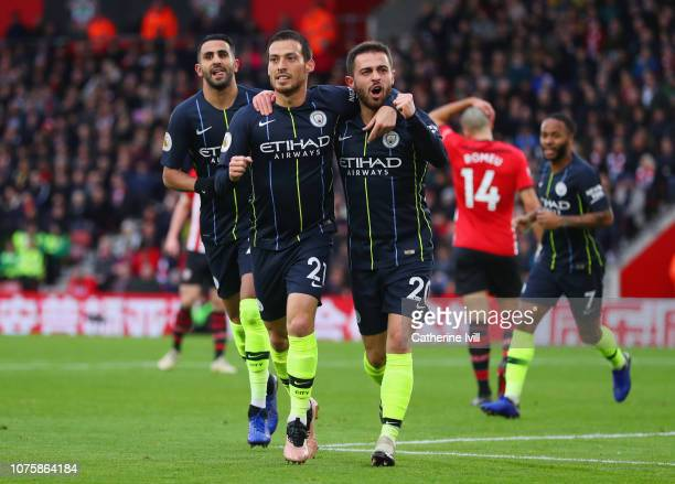 David Silva of Manchester City celebrates after scoring his team's first goal with team mates Bernardo Silva and Riyad Mahrez of Manchester City...