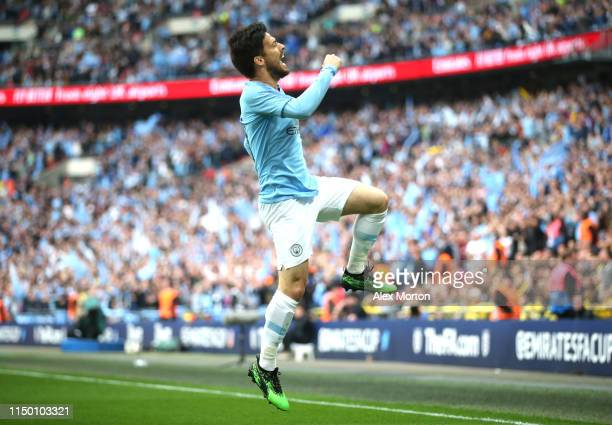 David Silva of Manchester City celebrates after scoring his team's first goal during the FA Cup Final match between Manchester City and Watford at...