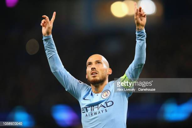 David Silva of Manchester City celebrates after scoring the opening goal during the UEFA Champions League Group F match between Manchester City and...