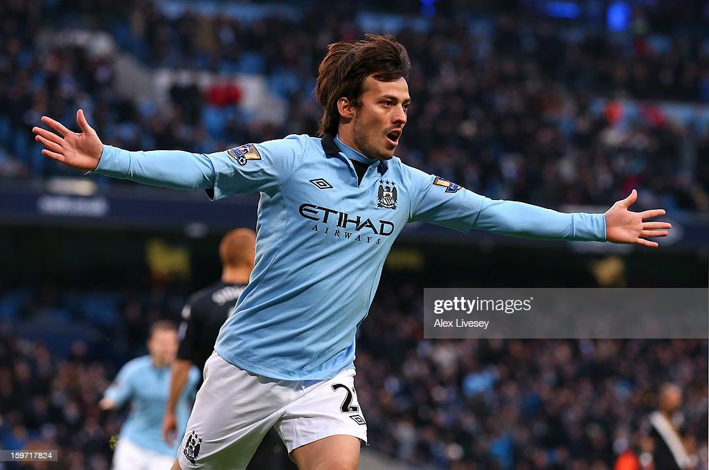David Silva of Manchester City celebrates after scoring the opening goal during the Barclays Premier League match between Manchester City and Fulham at Etihad Stadium on January 19, 2013 in Manchester, England.