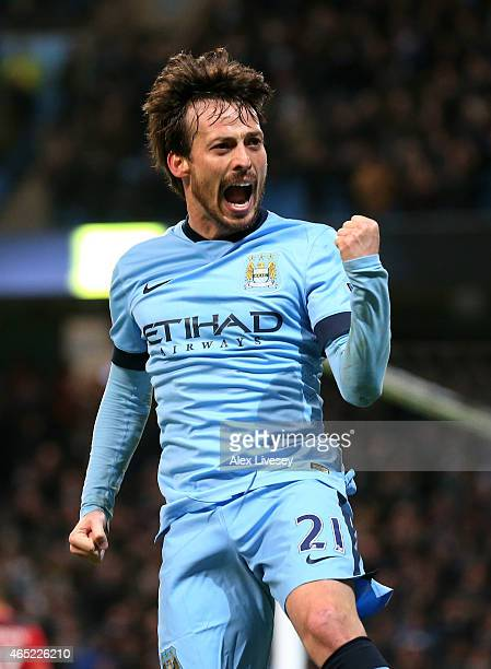 David Silva of Manchester City celebrates after scoring the opening goal during the Barclays Premier League match between Manchester City and...