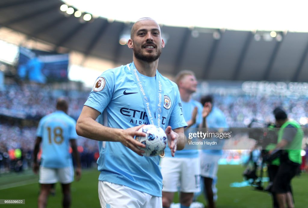 https://media.gettyimages.com/photos/david-silva-of-manchester-city-celebrates-after-the-premier-league-picture-id955339522
