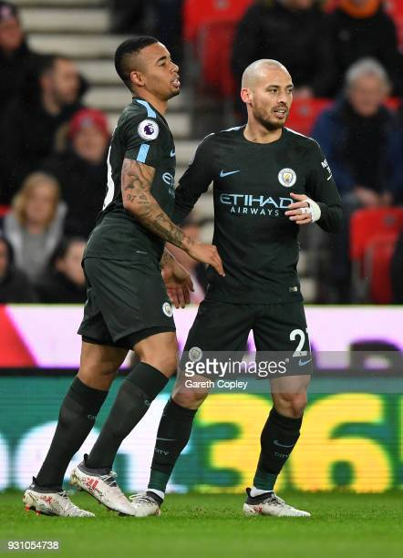 David Silva of Manchester City celebrates as he scores their first goal with Gabriel Jesus during the Premier League match between Stoke City and...