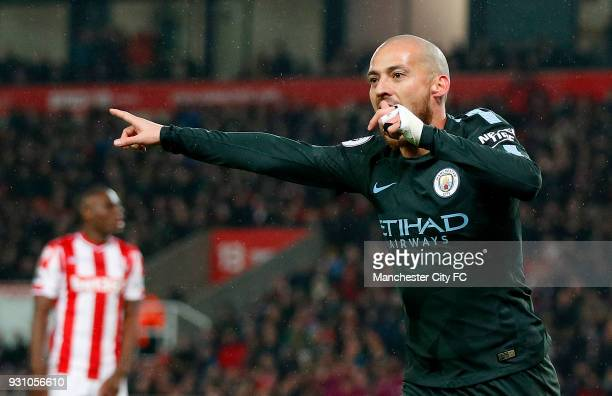 David Silva of Manchester City celebrates as he scores their first goal during the Premier League match between Stoke City and Manchester City at...