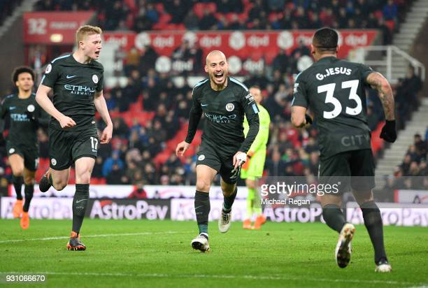David Silva of Manchester City celebrates as he scores their second goal with Kevin De Bruyne and Gabriel Jesus during the Premier League match...