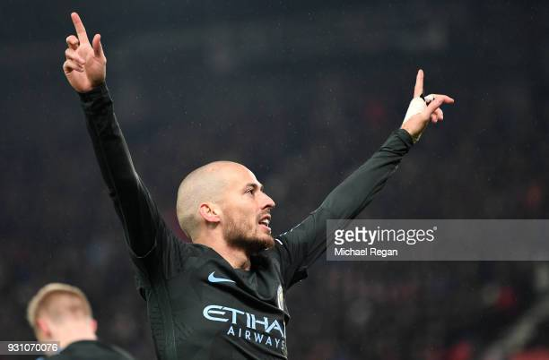 David Silva of Manchester City celebrates as he scores their second goal during the Premier League match between Stoke City and Manchester City at...