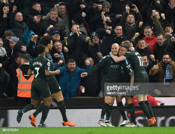 David Silva of Manchester City celebrates as he scores their second goal with team mates during the Premier League match between Stoke City and...