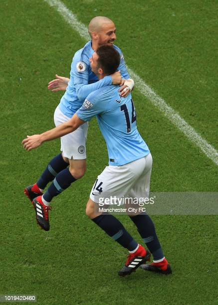 David Silva of Manchester City celebrates scoring his goal from a free kick with Aymeric Laporte during the Premier League match between Manchester...
