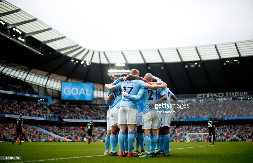 David Silva of Manchester City celebrates scoring his side's first goal with team mates during the Premier League match between Manchester City and Swansea City at Etihad Stadium on April 22, 2018 in Manchester, England.