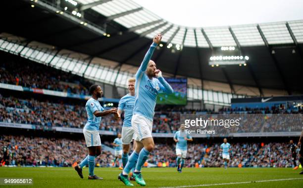 David Silva of Manchester City celebrates scoring his side's first goal during the Premier League match between Manchester City and Swansea City at...