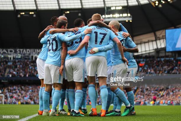 David Silva of Manchester City celebrates scoring his side's first goal with team mates during the Premier League match between Manchester City and...