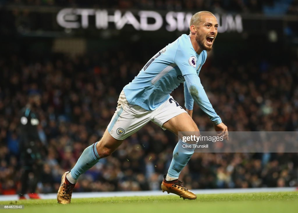 David Silva of Manchester City celebrates scoring his sides second goal during the Premier League match between Manchester City and West Ham United at Etihad Stadium on December 3, 2017 in Manchester, England.