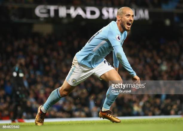 David Silva of Manchester City celebrates scoring his sides second goal during the Premier League match between Manchester City and West Ham United...