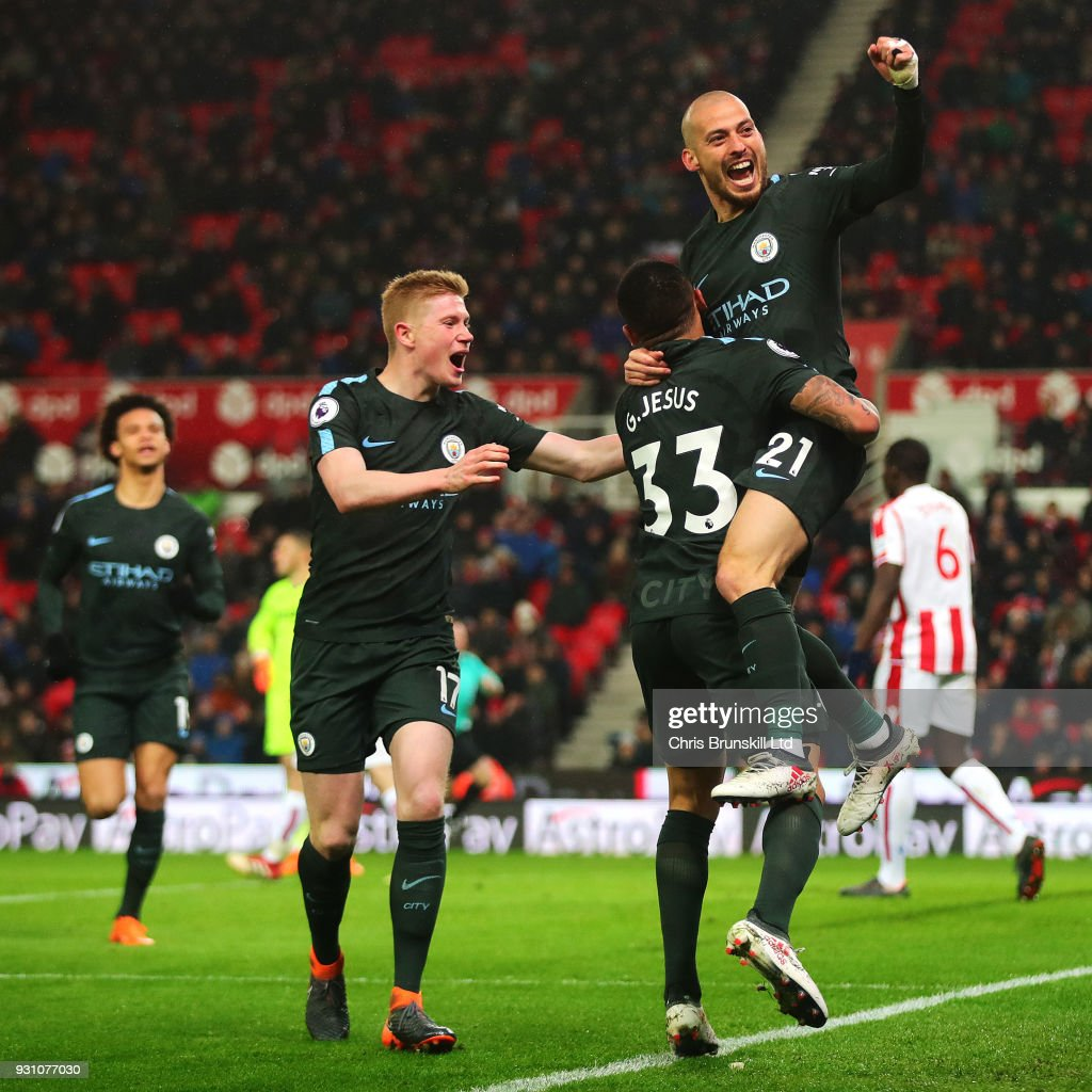David Silva of Manchester CIty celebrates scoring his side's second goal during the Premier League match between Stoke City and Manchester City at Bet365 Stadium on March 12, 2018 in Stoke on Trent, England.