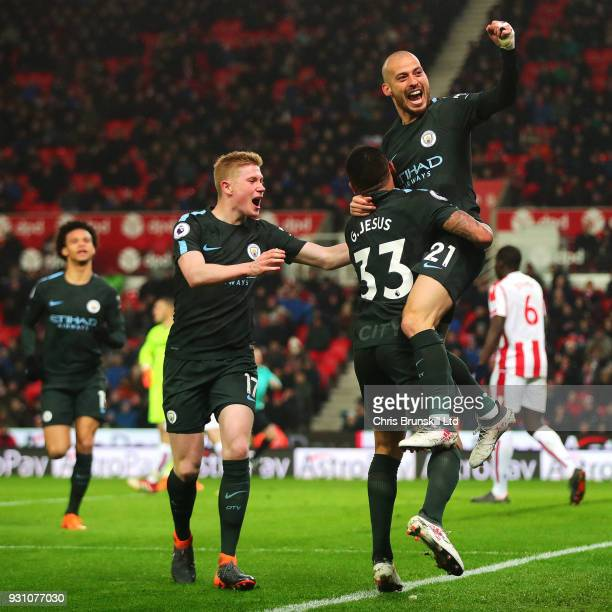 David Silva of Manchester CIty celebrates scoring his side's second goal during the Premier League match between Stoke City and Manchester City at...