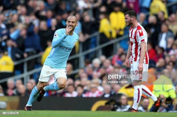 David Silva of Manchester City celebrates scoring his sides third goal during the Premier League match between Manchester City and Stoke City at...