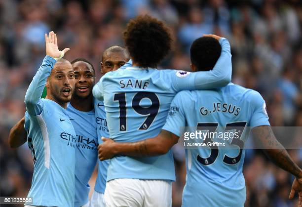 David Silva of Manchester City celebrates scoring his sides third goal with his Manchester City team mates during the Premier League match between...