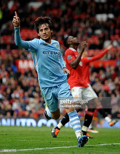 David Silva of Manchester City celebrates scoring his team's fifth goal during the Barclays Premier League match between Manchester United and...