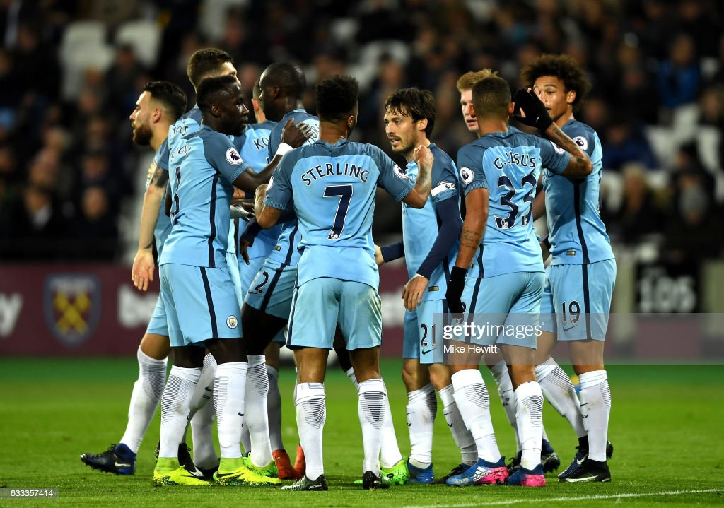 David Silva of Manchester City celebrates scoring his team's second goal with team mates during the Premier League match between West Ham United and Manchester City at London Stadium on February 1, 2017 in Stratford, England.