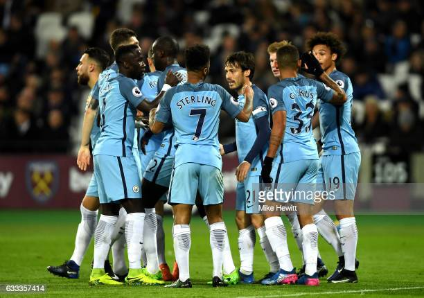 David Silva of Manchester City celebrates scoring his team's second goal with team mates during the Premier League match between West Ham United and...